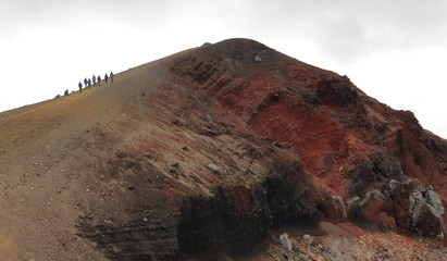 tourists on red crater in tongariro national park