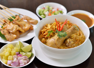 Khao Soi Chicken, northern Thai noodle dish with chicken and coc