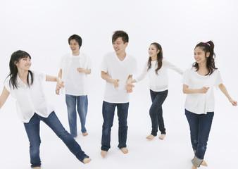 Young men and women dancing