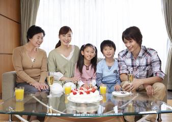 Three-generation family having a birthday party