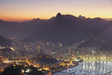 View of Christ the Redeemer statue and Botafogo Bay at sunset from Sugar Loaf Mountain, Rio de Janeiro, Brazil, South America