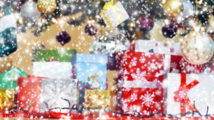 blurred of Christmas gift boxes under the tree background with s
