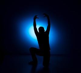 silhouette Rocker man posing on blue background