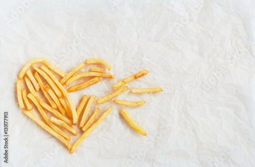 The Symbol Of Broken Heart Is Lined With French Fries On Kraft P