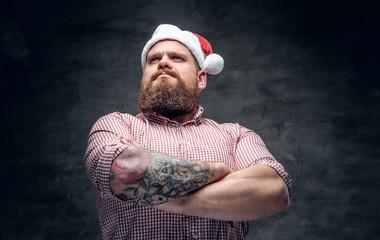 Bearded male wearing Santa's New Year hat.