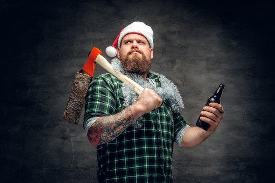 A man in Santa's hat drinking beer.