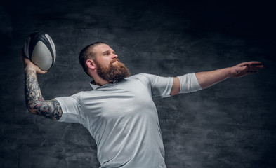 Brutal bearded rugby player in action.