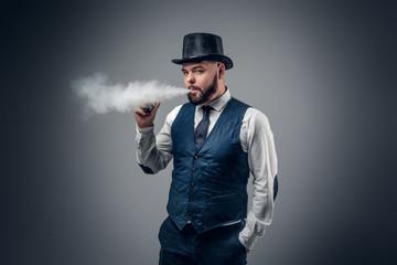 A man smoking an electronic cigarette.