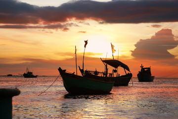 Silhouettes of anchored fishing boats