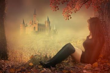 photomontage fantaisie d' une femme assise devant un château