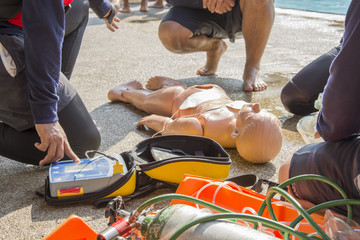 CPR child dummy drowning and use AED or PAD resuscitate