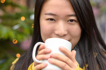 Smiling happy young Chinese woman