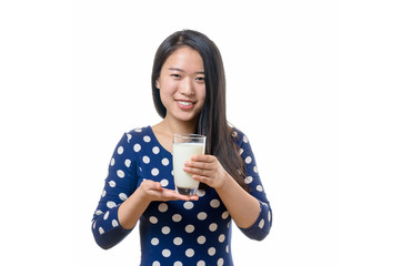 Young Chinese woman drinking a glass of milk