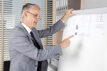 architect shows plans