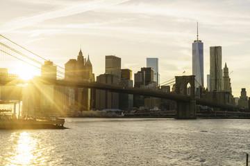 Brooklyn Bridge and Lower Manhattan skyline at sunset, New York City, New York, United States of America, North America