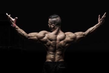 Man showing muscular Back Wall mural