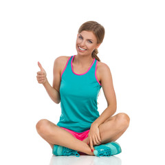 Woman In Vibrant Sports Clothes Showing Thumb Up
