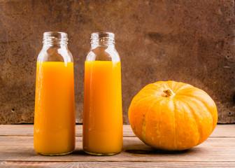 The fresh juice of ripe pumpkin bottled in small glass bottles.