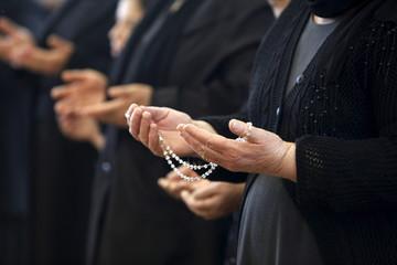 Senior woman holding rosary during Maundy thursday celebration