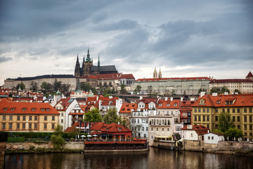 Colorful morning view of Charles Bridge, Prague Castle and St. Vitus cathedral on Vltava river. Sunny spring scene in Prague. Czech Republic - Prague old town view
