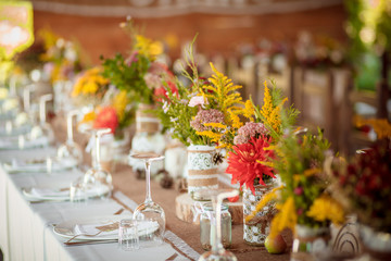 decorations made of wood and wildflowers served rustic