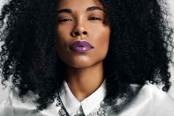 black woman with trendy violet glossy lips