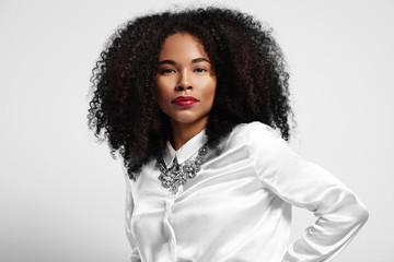 black woman in white shirt and curly hair