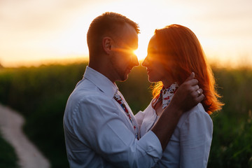 beautiful woman looking at her boyfriend on the sunset