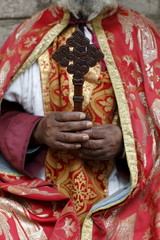 Coptic Orthodox priest holding a cross, Addis Ababa, Ethiopia, Africa