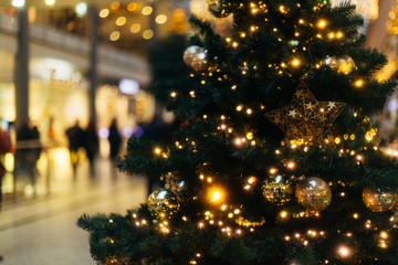 christmas time and tree in a blurred visual, in a commercial centre, Berlin