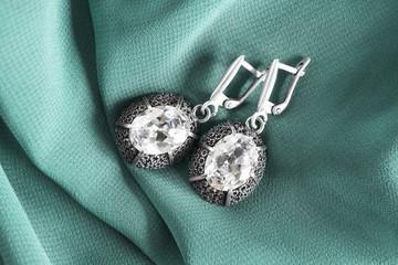 Earrings on silk