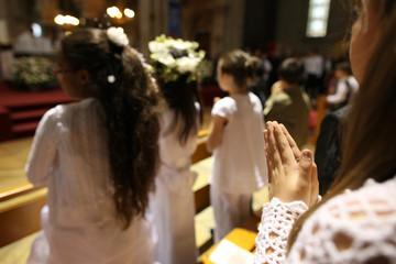 First Communion celebration in a Catholic church, Paris, France, Europe