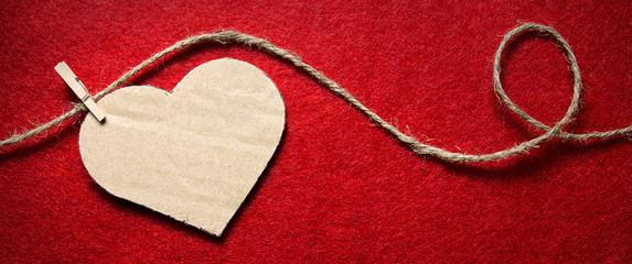 Heart From Cardboard On Rope With Clothespin On Red Background With
