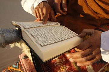 Tunisian Bedouin reading the Koran, Douz, Tunisia