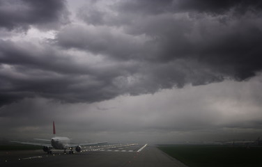 Plane ready for take off and stormy skies, Heathrow Airport, London, England, United Kingdom, Europe