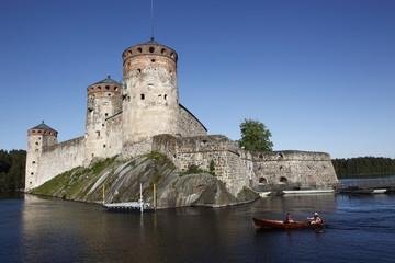 Girls relaxing beside Olavinlinna Medieval Castle (St. Olaf's Castle), Savonlinna, Saimaa Lake, Savonia, Finland, Scandinavia, Europe