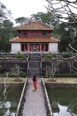 Vietnamese schoolgirl walking over bridge to Minh Lau Pavilion (Bright Pavilion), Hue, Vietnam, Indochina, Southeast Asia, Asia