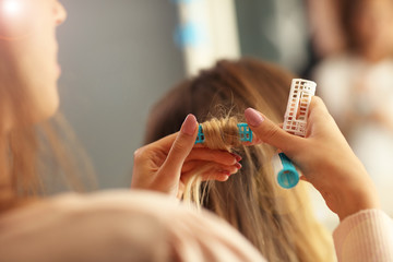 Hairdresser curling hair