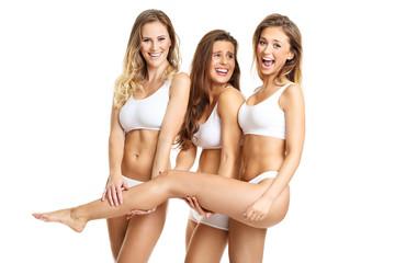 Group of happy friends posing in underwear