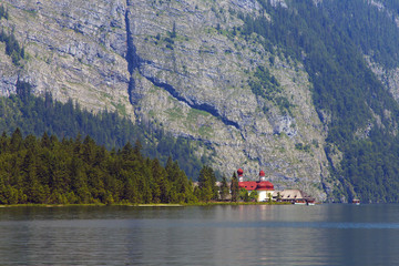 View of the lake of Königsee with st Bartholoma church, Berchtesgaden National Park, Germany