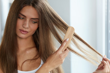 Hair Care. Beautiful Female Hair brushing Long Hair With Brush