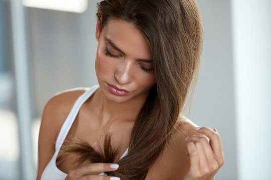 Beautiful Woman With Split Ended Hair. Health And Beauty Concept