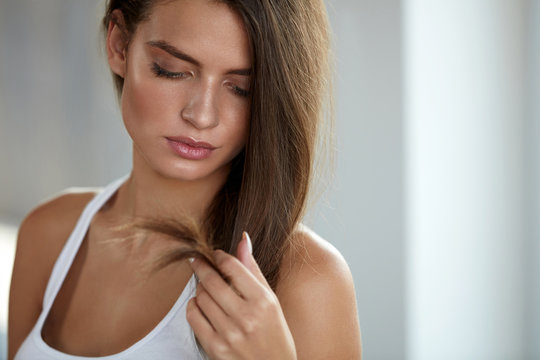 Beautiful Woman With Split Ended Hair. Hair Care Concept