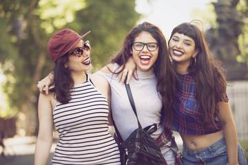 Happy group of teen friends having fun outdoors