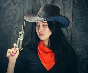 beautiful girl cowboy girl with a gun, a criminal