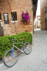 Fototapete - Bicycle in old street in old town Pienza of Tuscany, Italy