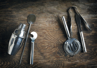 Set of bar accessories on wooden background with copy space