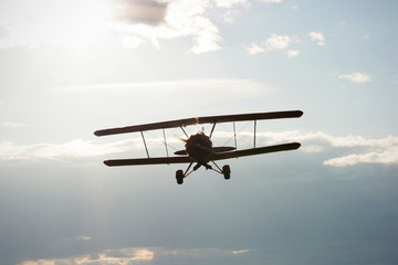 microlight biplane flying towards