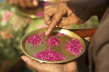 Small ruby stones bought by buyers on the market of Mogok, Myanmar (Burma), Asia