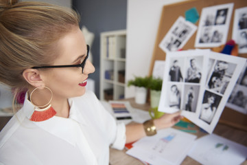 Woman reviewing pictures in office place